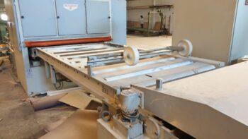 Transfer between sanding machines