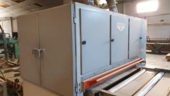 Top panel sanding machine